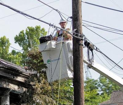 Cox Communications lineman working to restore service