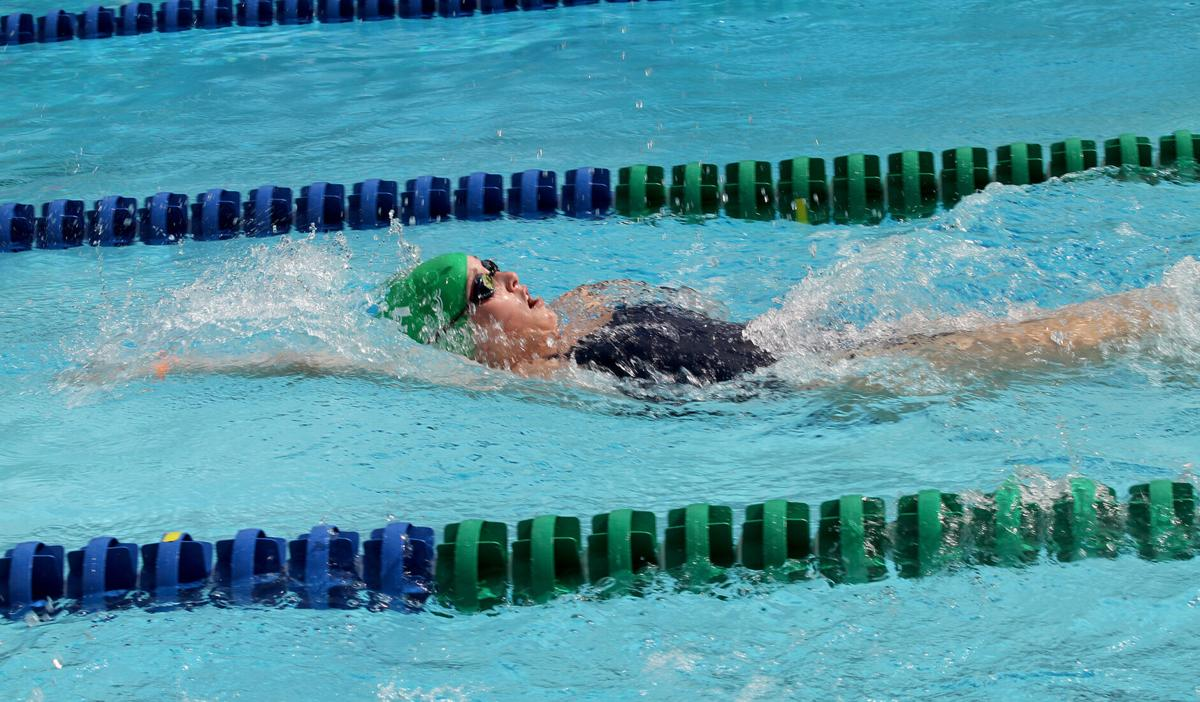 St. Scholastica trio swim together competitively for final time