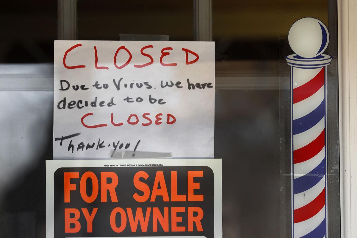 Coronavirus file photo stock of closed business sign