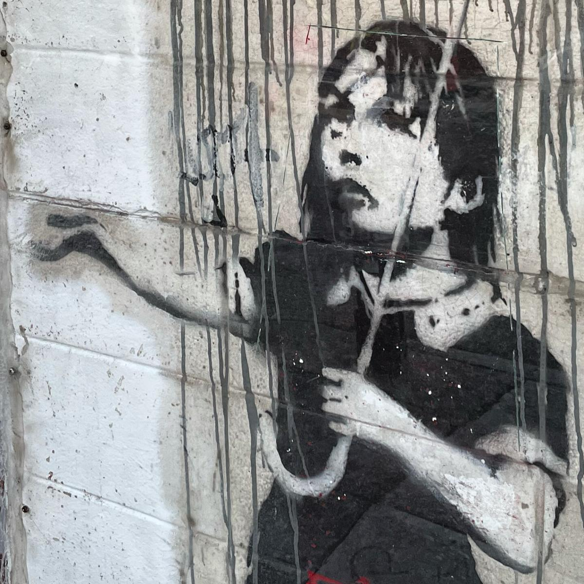 A Banksy graffiti painting vandalized on Christmas was restored by fast-acting artists 1.jpeg