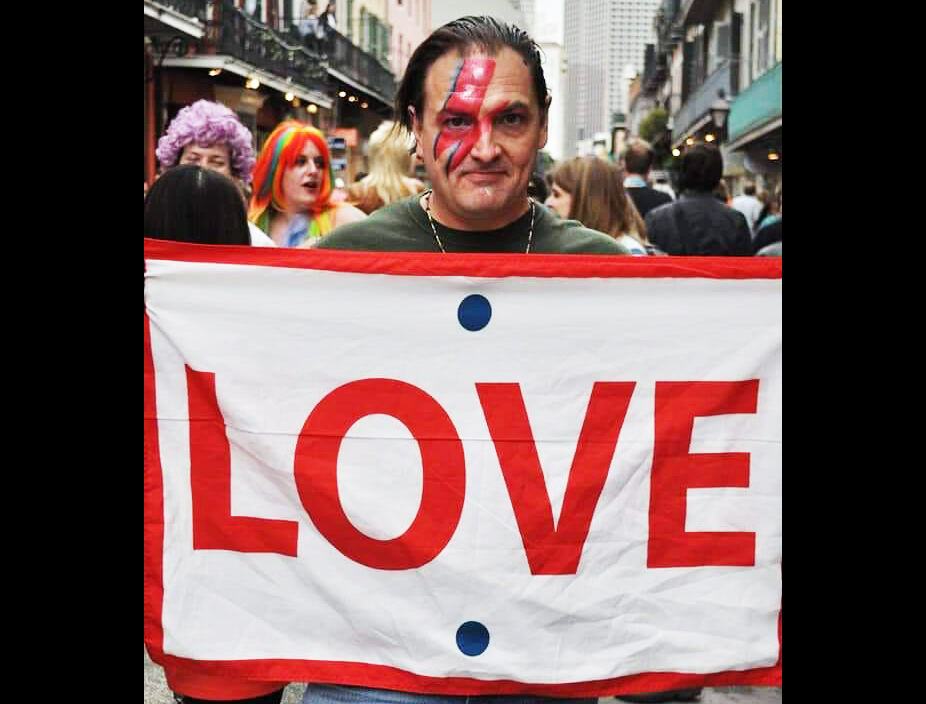 John Hebert, co-founder of the LOVE signs anti-violence street art campaign