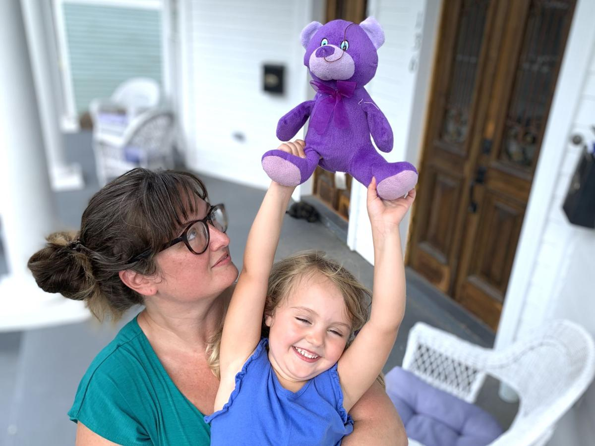 """Jessica and Edith """"Eddy"""" Arnold with the once-missing Purple Bear .jpeg"""
