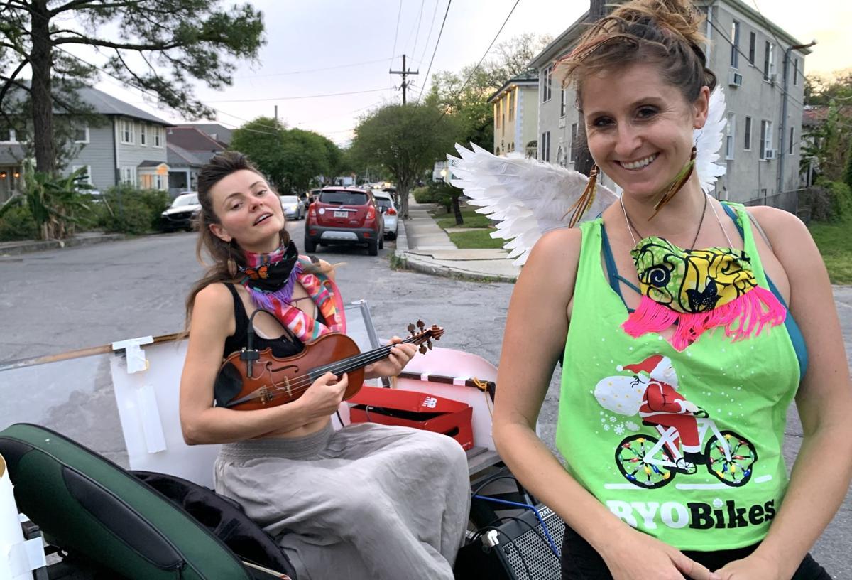 French Quarter street musician Anna Roznowska and pedicab operator Sarah Grant