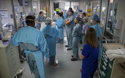Doctors and nurses treat COVID patients in Baton Rouge