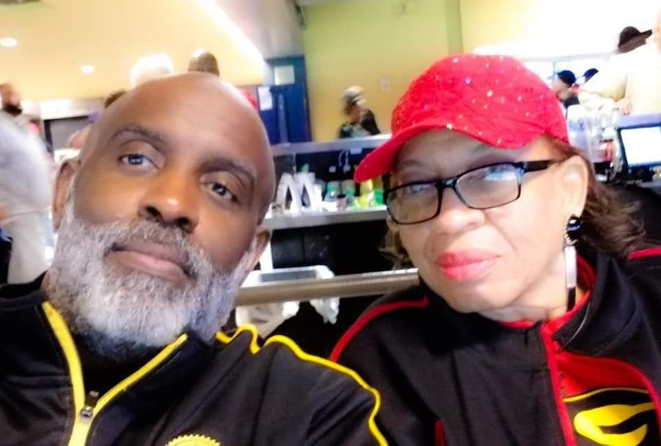 Higgins with son, Raynald Higgins, at the Bayou Classic 2018