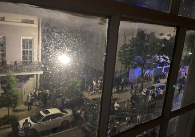 A crowd gathers outside a DJ party in downtown New Orleans on June 19.
