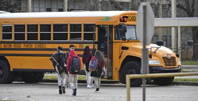 Students getting into a school bus in Baton Rouge