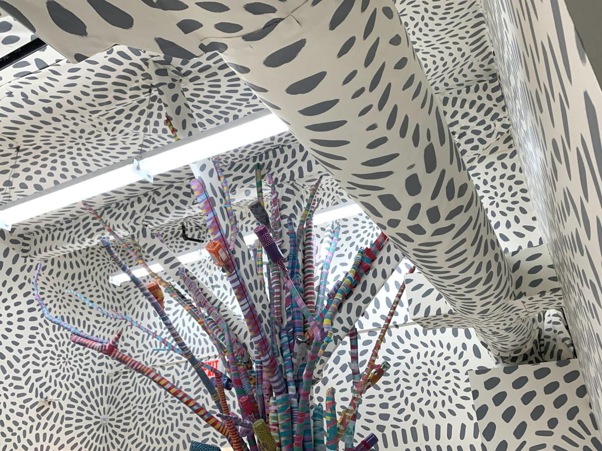 JAMNOLA's unfinished bottle tree installation by The Milagros Collective