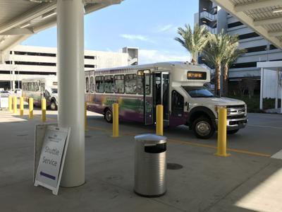 MSY shuttle service stop outside main terminal