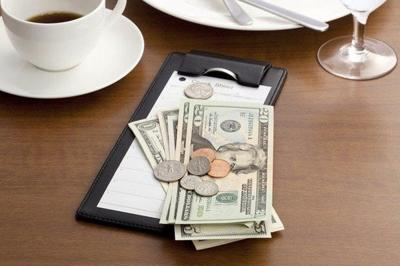 How should tips be divided among restaurant workers? Question at center of Dat Dog lawsuit