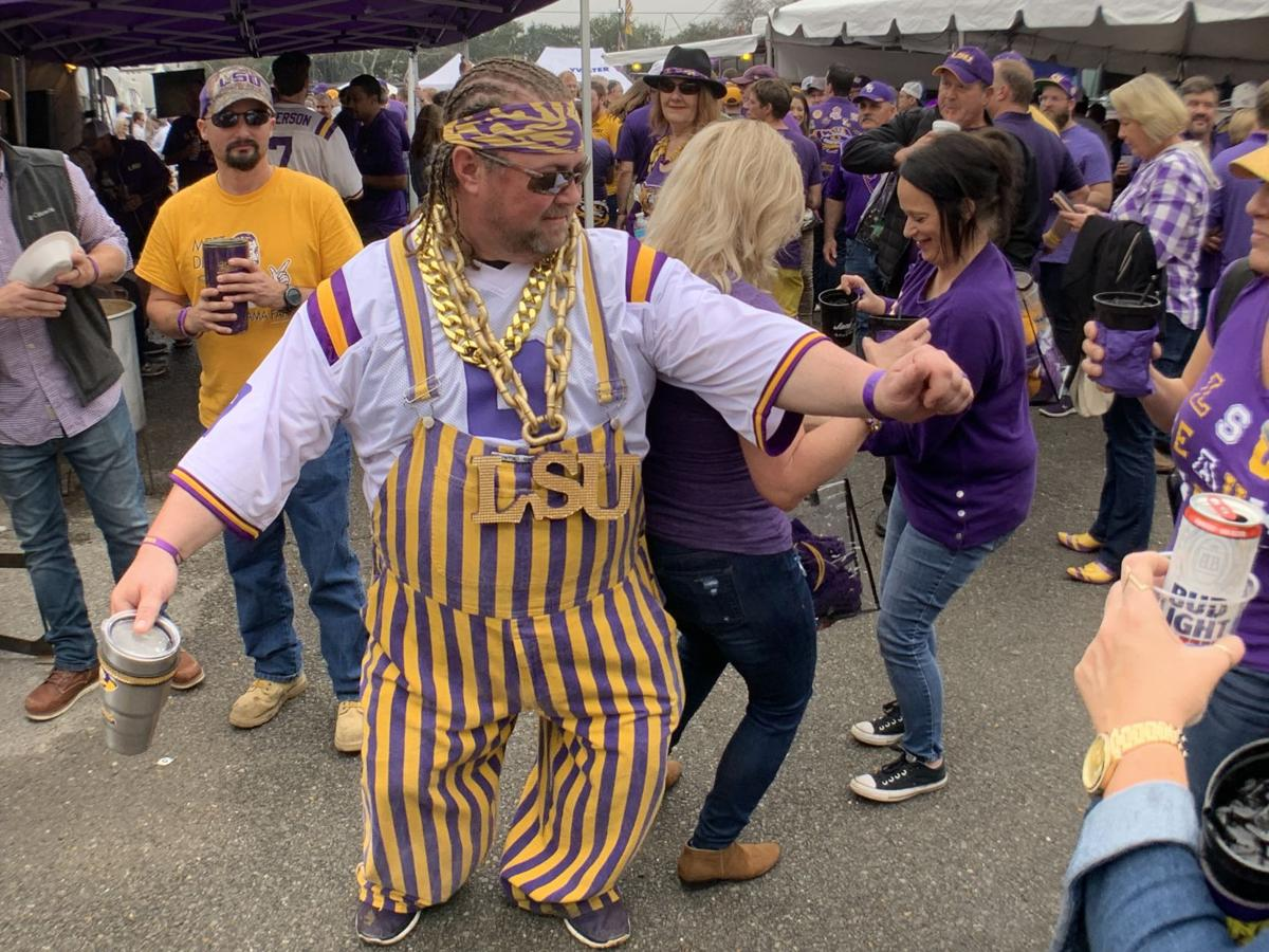 Josh Johnson of Baton Rouge trips the light fantastic as the Unsupervised and Kroux LSU tailgating clubs join forces for the College Football Playoff National Championship game in New Orleans