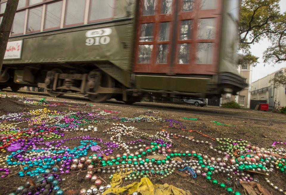 A New Orleans streetcar rumbles past forsaken beads after Mardi Gras 2017