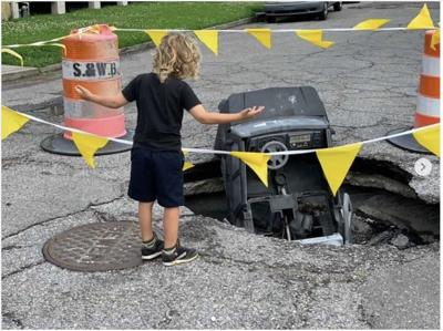 kid and a pothole.jpg