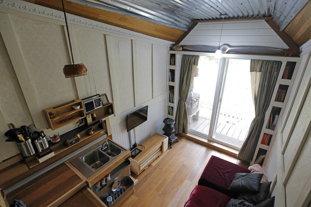Think you can live in 100 square feet? Tiny house owners do