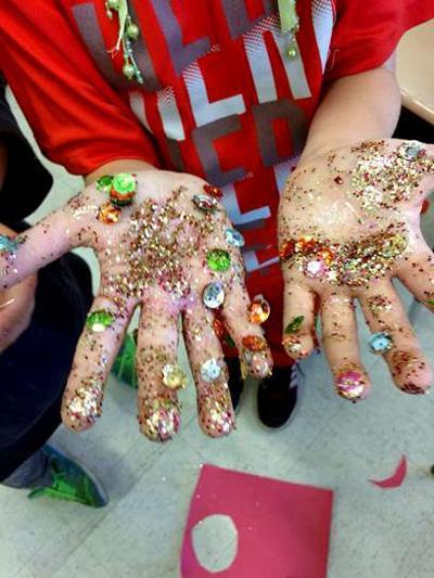 Plessy_shoebox_floats_glitter_hands