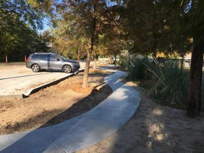 Old Mandeville parking slab near church to be altered
