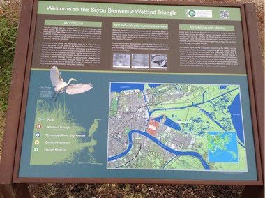 New signs explain importance of restoring cypress in Bayou Bienvenue Wetlands Triangle next to the Lower 9th Ward