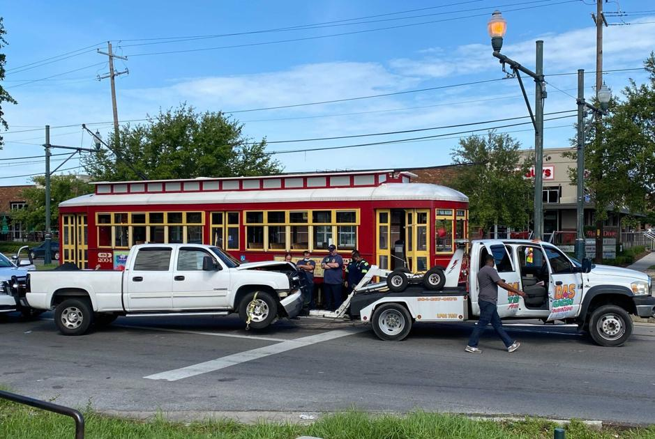 Two injured after pickup truck and streetcar collide on North Carrolton Avenue