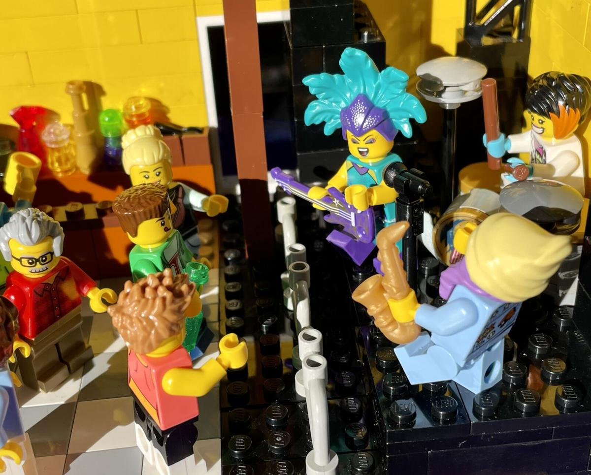 Amy Murphy's LEGO model of Tipitina's nightclub includes Valerie Sassyfras on guitar.jpeg