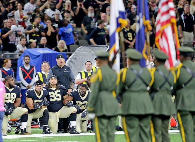 Fans boo kneeling New Orleans Saints players during tribute to fallen NOPD officer