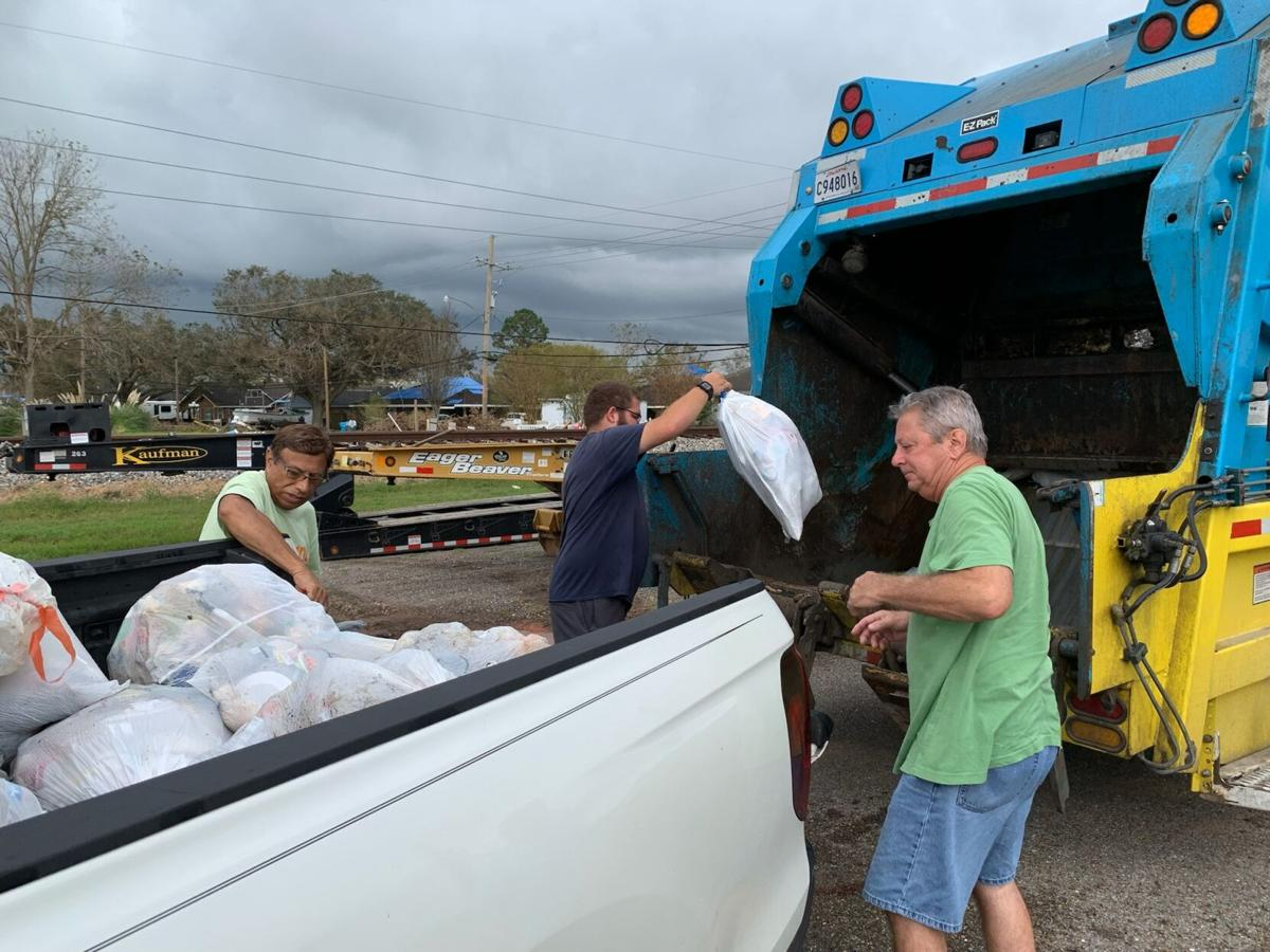 St. Charles residents unload their garbage post Ida