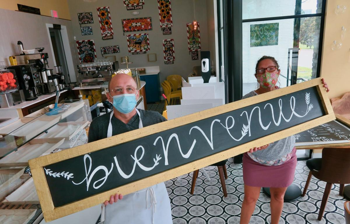 """Dominique Rizzo and Sirlei guidry hold up the """"welcome"""" sign at Celtica French Bakery in Lakeview. Staff photo by Ian McNulty"""