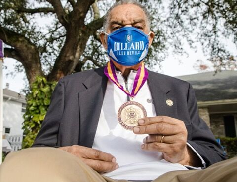 Dr. Sutton with Omega 70-year medallion