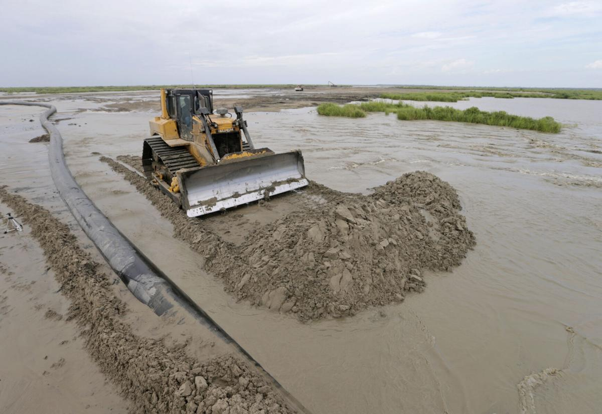 Dredging and pipelines build wetlands
