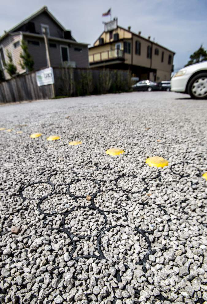 'Only way to go': New surfaces absorb rain to help curb flooding, aid drivers, property owners _lowres