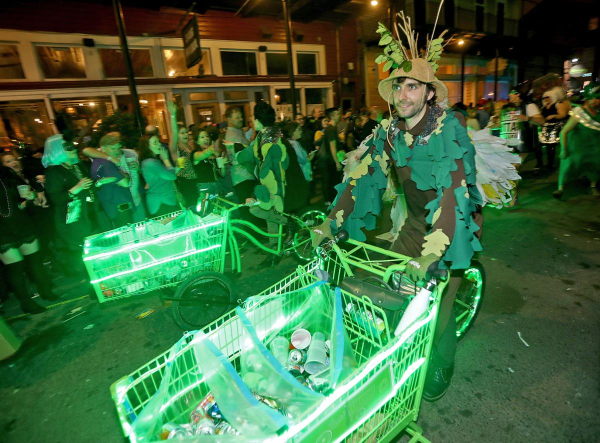 The TrashFormers collect recyclables from revelers during the 2019 krewedelusion parade.