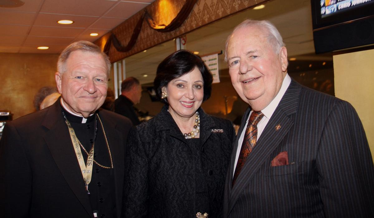 Tom and Gayle Benson with Archbishop Gregory Aymond
