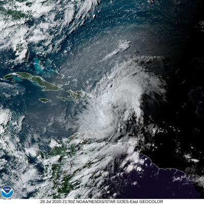 Tropical system gaining strength in Caribbean