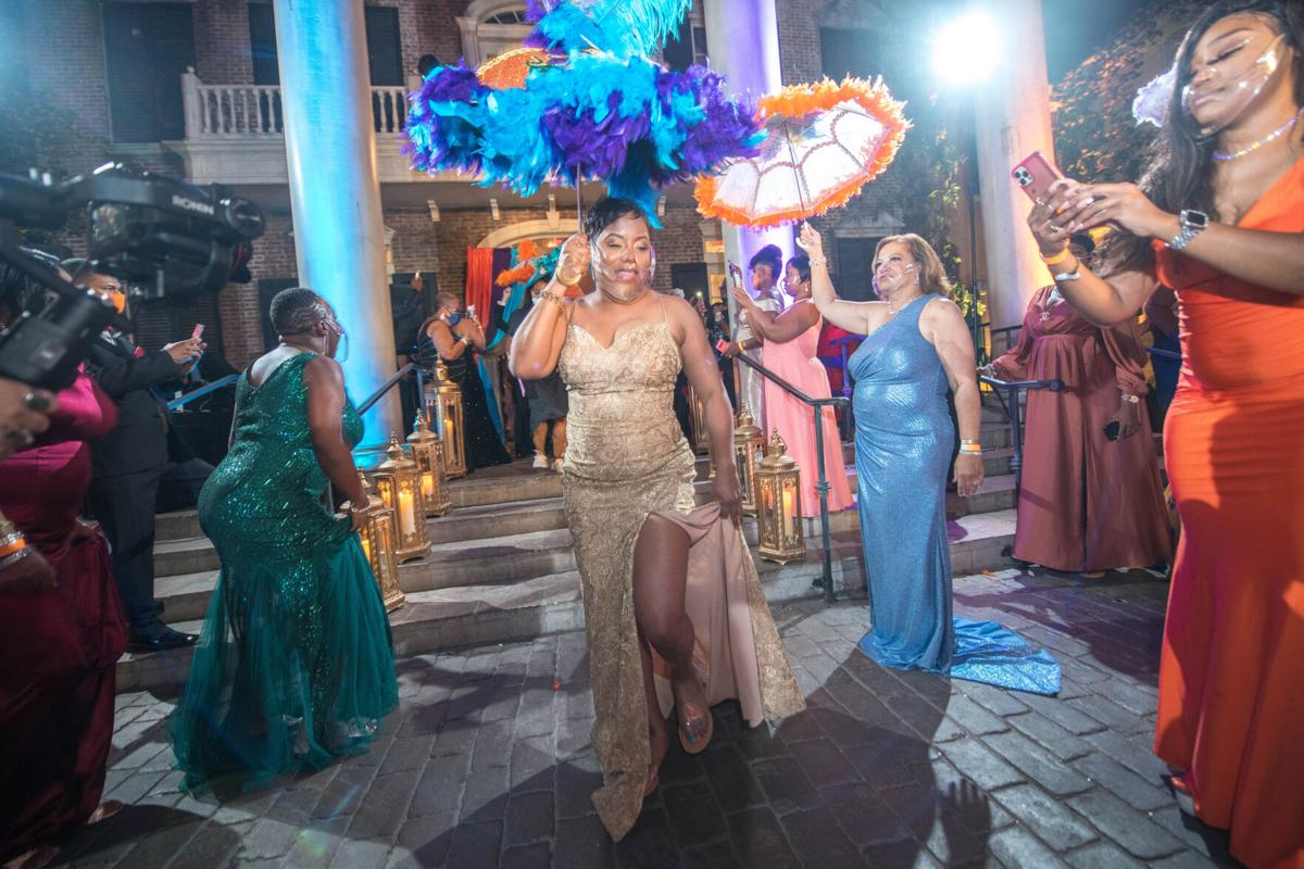 Captain Chantell Reed leads a second-line parade during the first Krewe of Harmonia ball