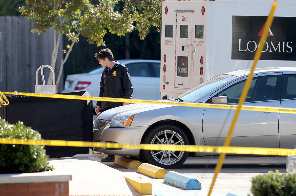Armored truck guard gunned down while unloading money at