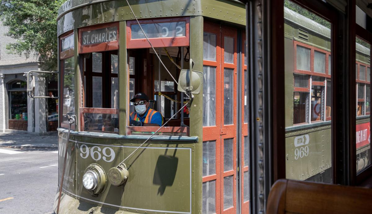 Coronavirus file photo stock of streetcar conductor with mask