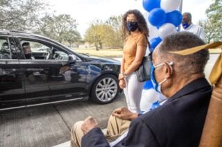 Dr. Norman Francis leads the drive through