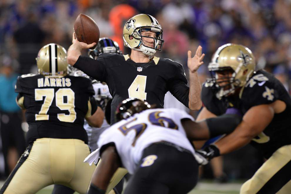 Saints backup quarterbacks Luke McCown and Ryan Griffin hold their ...