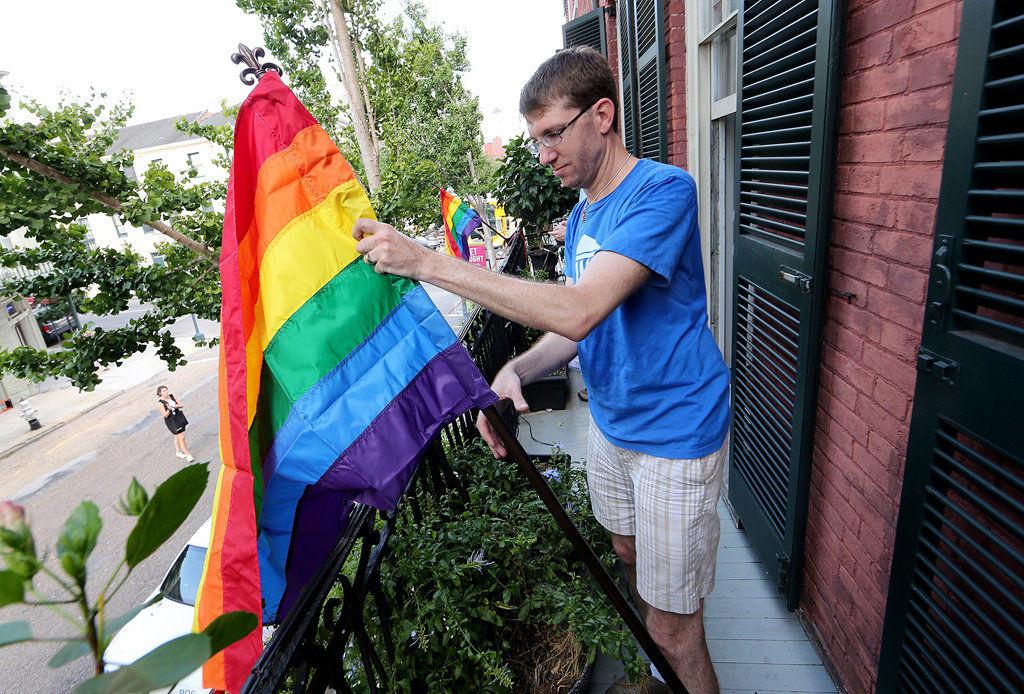 Gay-pride flag stolen, slur spray-painted at activist's Julia Street home