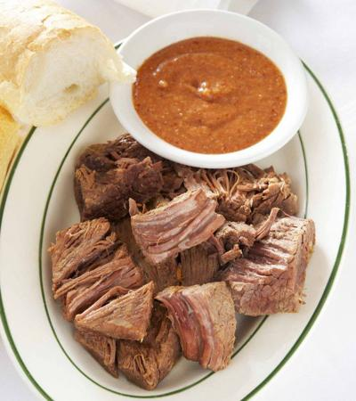 Tujague's restaurant's $18.56 lunch, gives a nod to its opening 160 years ago