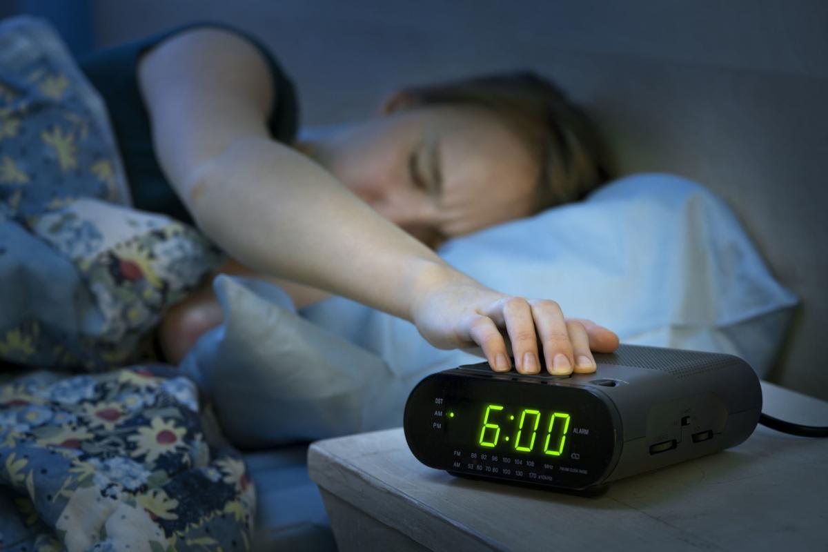 Female teen turning off alarm