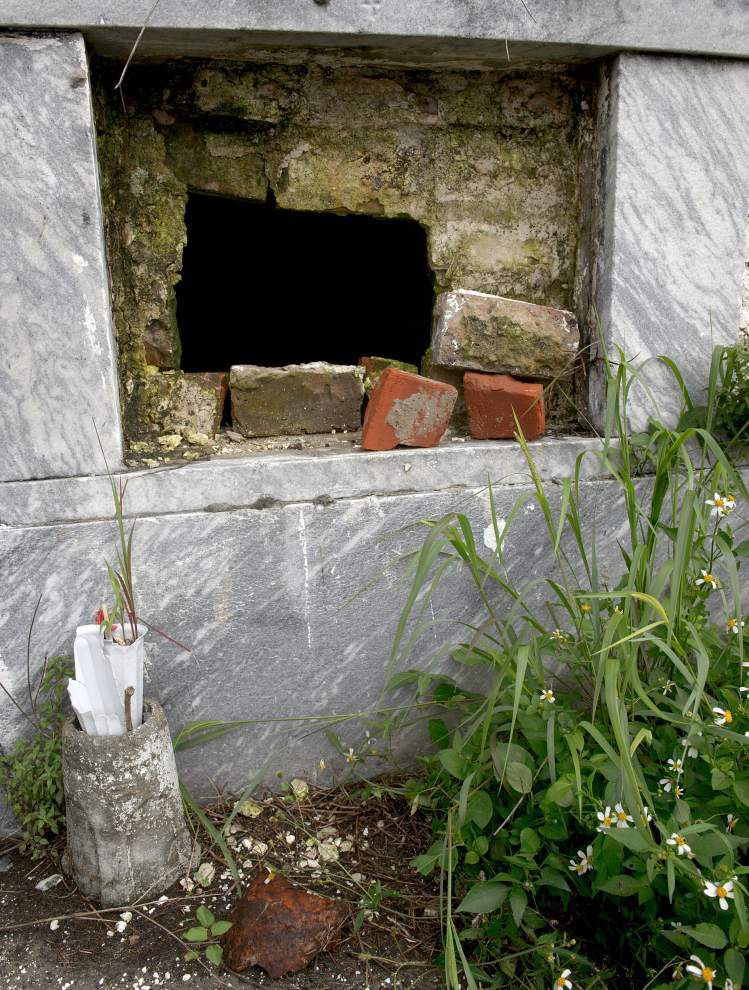 Vaults broken into, remains exposed at New Orleans' historic Lafayette cemetery _lowres