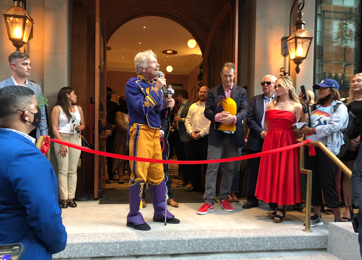 Richard Branson cuts the ribbon on his new $80 million hotel in downtown New Orleans, October 7, 2021