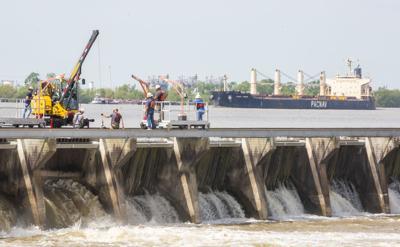 Spillway closure begins.