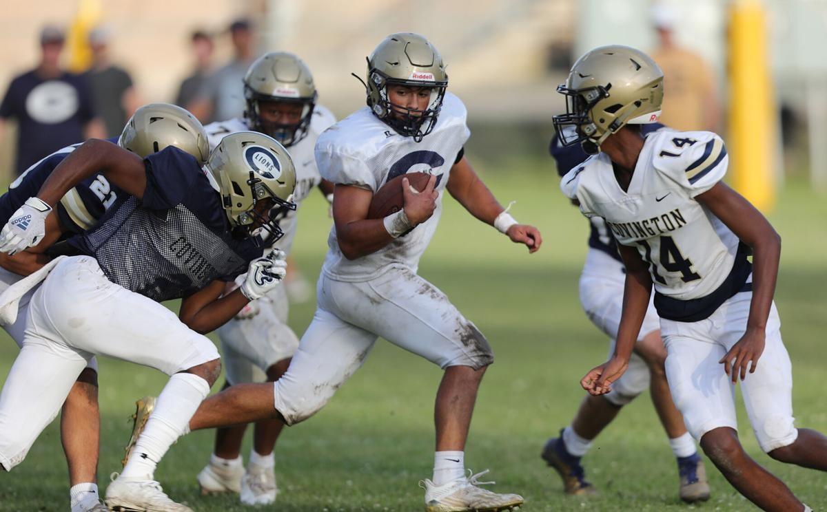 Bryce Blackwell runs a play out of the backfield for Covington
