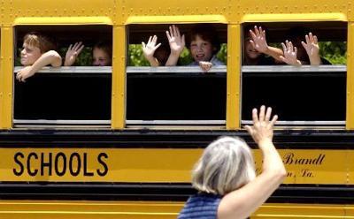 School bus pulls away from Covington Elementary