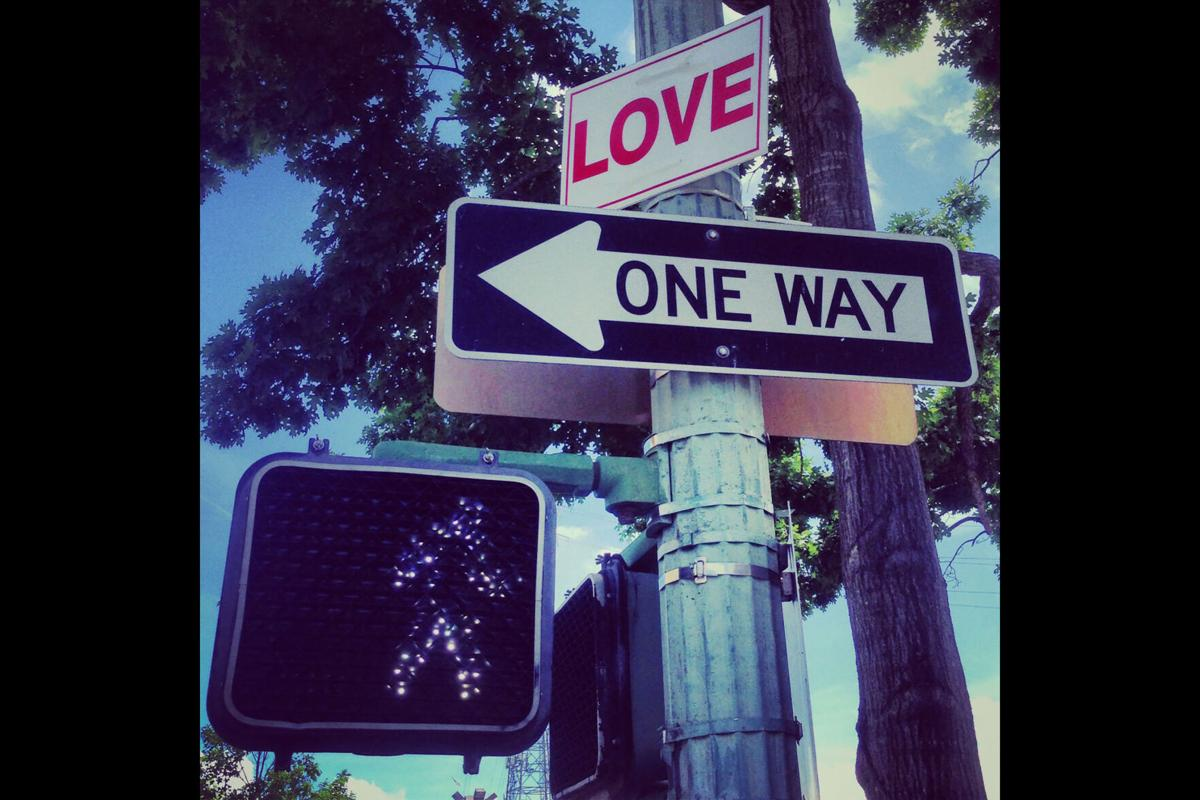 LOVE signs, an anti-violence street art project, became a sensation in 2014.jpg