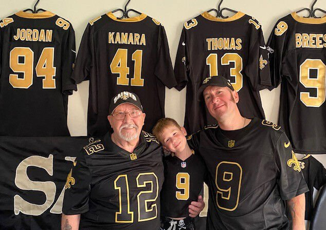 Canadian Who Dat Duane Dawson (right) his son Kaden and dad Doug in his Saints Shack - PHOTO COURTESY DUANE DAWSON.jpg