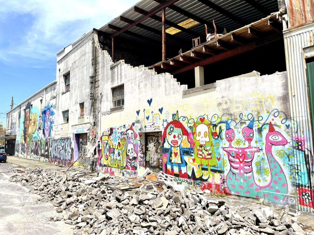 A wall at the former Frankie and Johnny's furniture store collapsed during Hurricane Ida, jeopardizing a mural by street artist Crude Things.jpeg