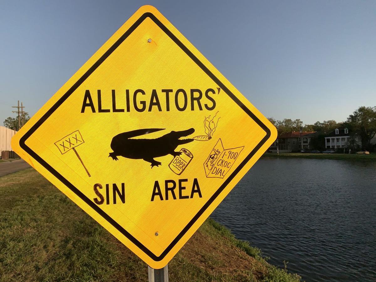 Altered Alligators In Area sign on Bayou St.John