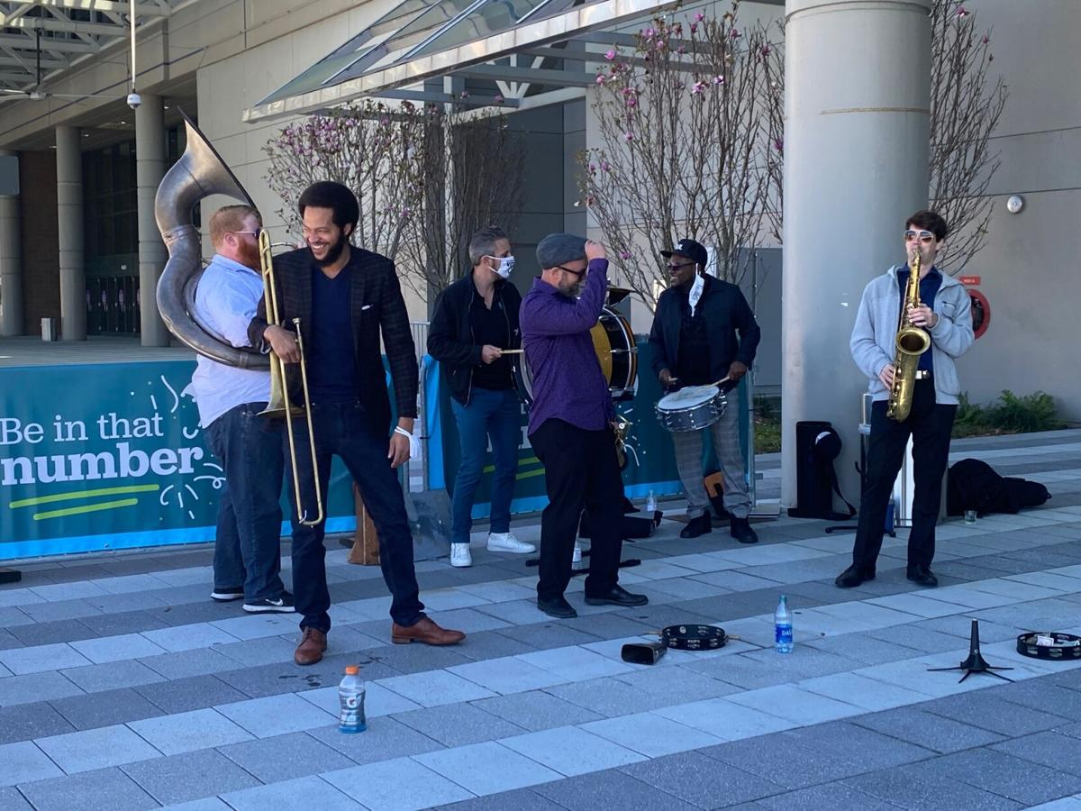 Soul brass band vaccination site performance